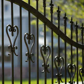 Wrought iron tracery black fence